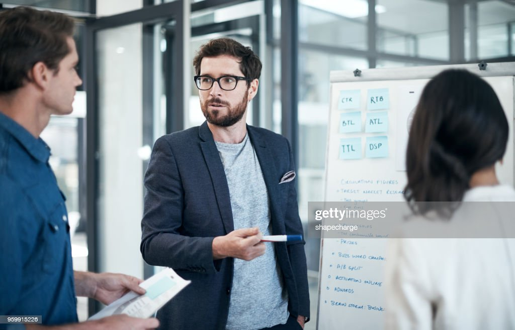 Combining their brainpower for a successful brainstorming session : Stock Photo