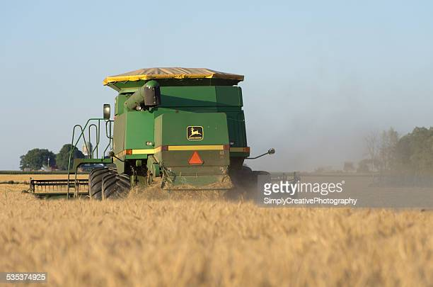 combining wheat - threshing stock photos and pictures