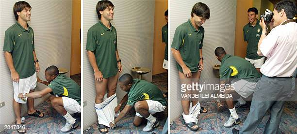 Combo of 3 pictures of Robinho player of the Brazilian Under23 soccer team joking with teammate Diego who pulls down his shorts while a photographer...