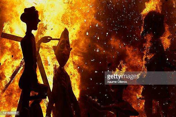 Combustible 'Ninot' caricatures burn during the last day of the 'Fallas' festival on March 19 2012 in Valencia Spain The festival which runs March 15...