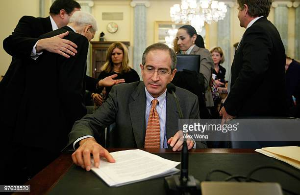 Comcast Corporation Chairman and CEO Brian Roberts waits for his turn to testify as his father Comcast founder Ralph Roberts is led to his seat...