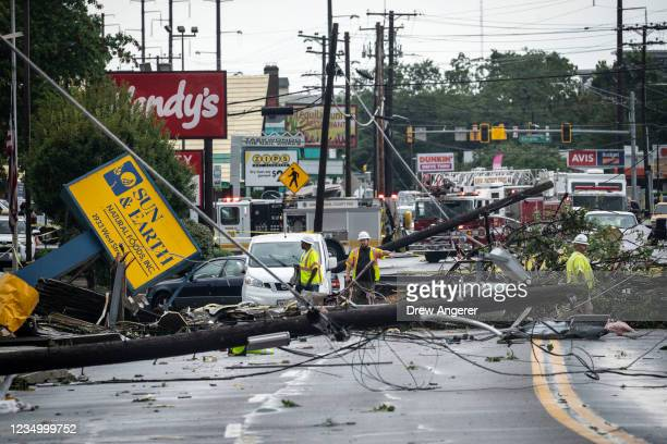 Comcast utility workers survey the damage from a tornado on West Street in Annapolis, Maryland on September 1, 2021. The remnants of Hurricane Ida...
