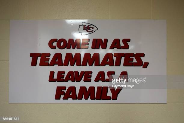 Come In As Teammates, Leave As A Family' signage hanging on the wall of the team's locker room inside Arrowhead Stadium, home of the Kansas City...