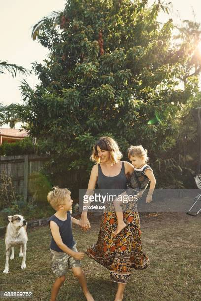 come on, mom! - family with two children stock photos and pictures