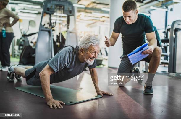 come on, one more push-up! - athleticism stock pictures, royalty-free photos & images