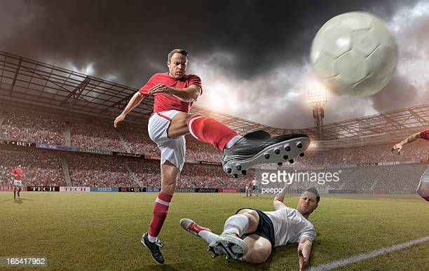come up soccer player kicking football - tackling stock pictures, royalty-free photos & images