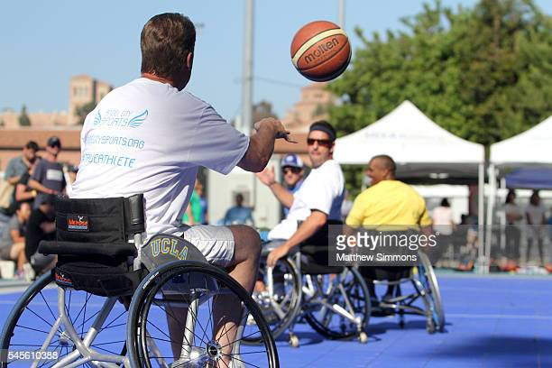 Comedian Adam Sandler plays in a celebrity wheelchair basketball game during the 2nd Annual Angel City Games at UCLA's Drake Stadium on July 8, 2016...