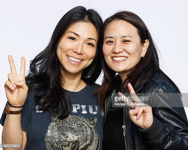 Comedian Aiko Tanaka and Julie Kang pose after Aiko's performance at The Ice House Comedy Club on June 6 2014 in Pasadena California