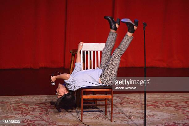 Comedian Ali Wong performs during One Kid One World's 3rd Annual Night Of 18 Laughs at Largo on April 27 2014 in Los Angeles California