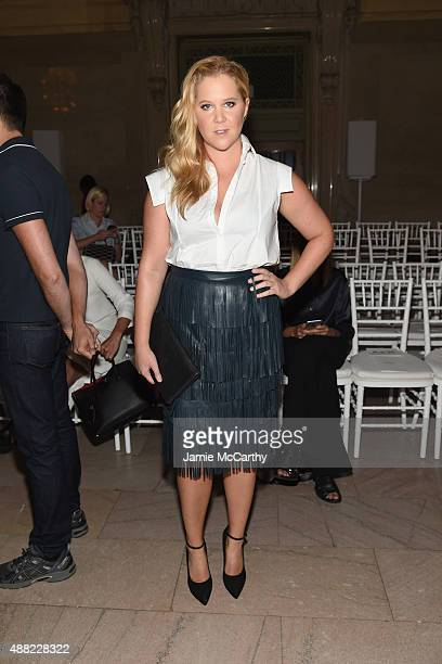 Comedian Amy Schumer attends the Zac Posen Spring 2016 fashion show during New York Fashion Week at Vanderbilt Hall at Grand Central Terminal on...