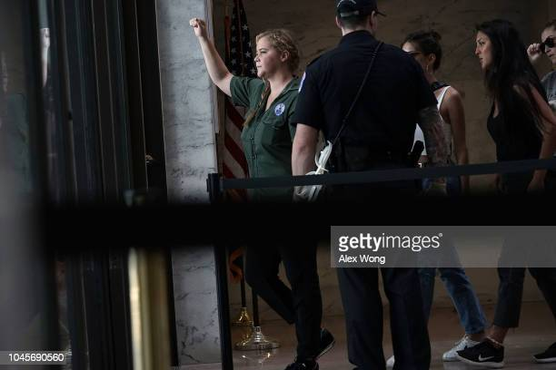 Comedian Amy Schumer is led away after she was arrested during a protest against the confirmation of Supreme Court nominee Judge Brett Kavanaugh...