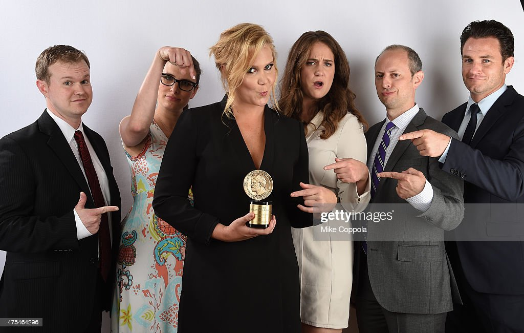 Comedian Amy Schumer (center) poses with her award with guests from 'Inside Amy Schumer' at The 74th Annual Peabody Awards Ceremony at Cipriani Wall Street on May 31, 2015 in New York City.