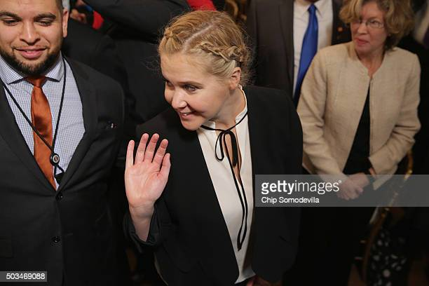 Comedian Amy Schumer waves goodbye after listening to US President Barack Obama deliver remarks about his efforts to increase federal gun control in...