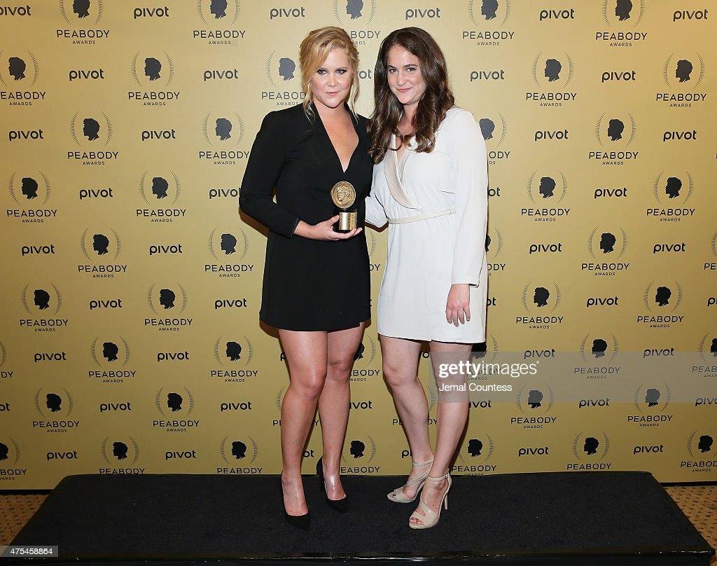 Comedian Amy Schumerb (L) and Kim Caramele pose at The 74th Annual Peabody Awards Ceremony at Cipriani Wall Street on May 31, 2015 in New York City.