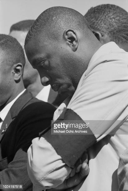 Comedian and activist Dick Gregory wearing a black armband at a civil rights demonstration in Washington DC in the aftermath of the bombing of the...