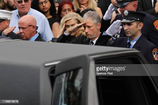 Comedian and activist Jon Stewart and US Rep Carolyn Maloney salute the casket of retired NYPD detective Luis Alvarez as it is brought into...