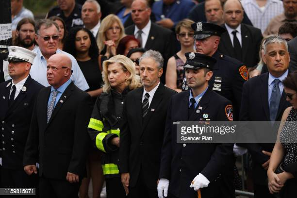 Comedian and activist Jon Stewart stands with US Rep Carolyn Maloney as the casket of retired NYPD detective Luis Alvarez is brought into Immaculate...