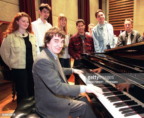 Comedian and actor Dudley Moore launches his new cartoon series 'Oscar's Orchestra' with the help of Jodie Dilworth Nicholas Shipman Helena Price Dan...