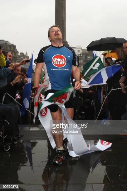 Comedian and actor Eddie Izzard completes his run around the UK in aid of Sport Relief at Trafalgar Square on September 15 2009 in London England...