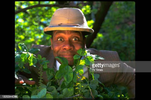 Comedian and actor Lenny Henry posed outdoors with a pith helmet in publicity stills for his documentary Lenny's Big Amazon Adventure, circa 1997.