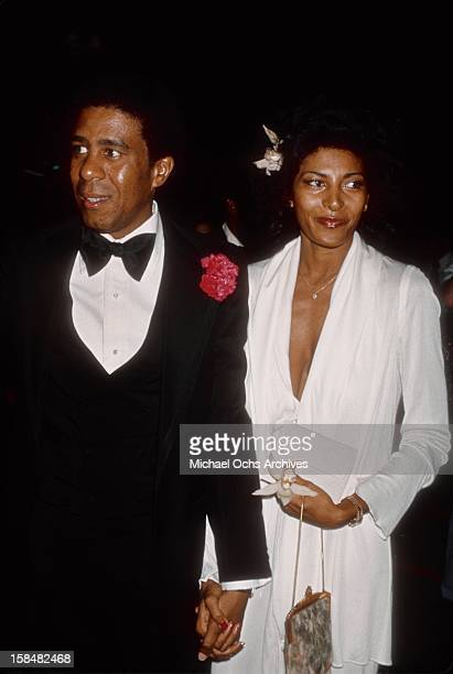Comedian and actor Richard Pryor and actress Pam Grier attend the 19th Annual Grammy Awards at The Hollywood Palladium in Los Angeles, California.