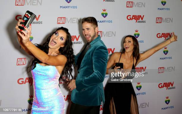 Comedian and adult film actress Silvia Saige adult film actor Wesley Woods and adult film actress Alexis Fawx take selfies during the 2019 GayVN...