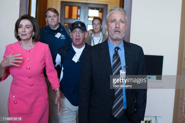 Comedian and advocate Jon Stewart Speaker Nancy Pelosi DCalif and 9/11 responder John Feal center make their way to the Speaker's balcony for a photo...