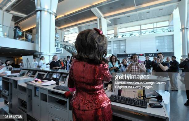 USA Comedian and 'air hostess' Pam Ann chats makes gate announcements before passengers board JetBlue's JetPride flight 1969 from San Francisco to...