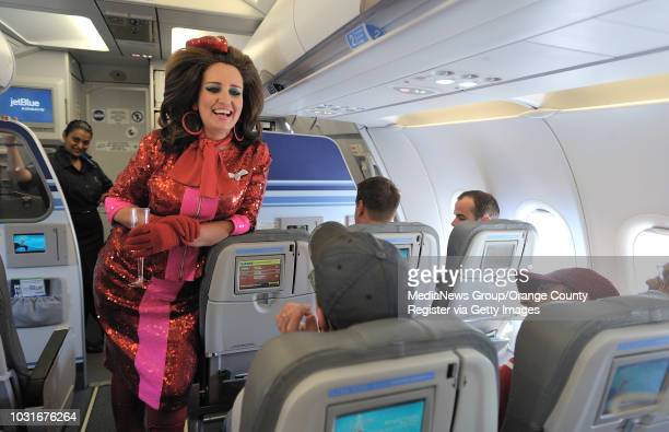 USA Comedian and 'air hostess' Pam Ann chats with passengers after pouring champaign during JetBlue's JetPride flight 1969 from San Francisco to Long...