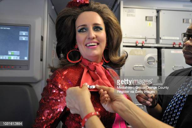 USA Comedian and 'air hostess' Pam Ann gets her wings aboard JetBlue's JetPride flight 1969 from San Francisco to Long Beach CA on May 14 2010...