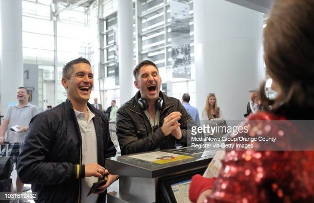 USA Comedian and 'air hostess' Pam Ann keeps passengers Stephen Kling left and Angelo Prato laughing as she pokes fun at them before boarding...