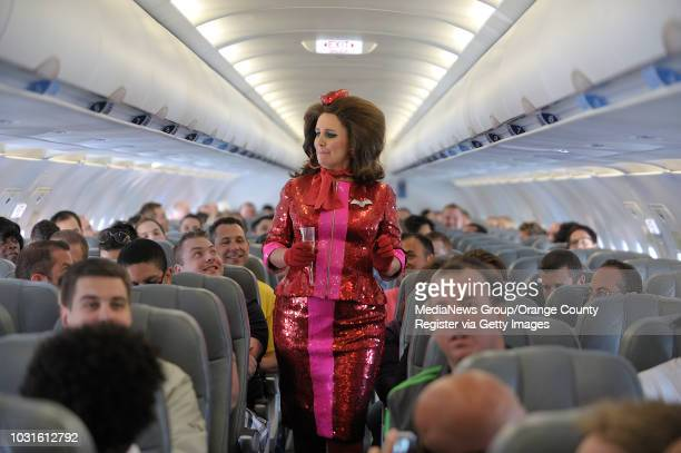 USA Comedian and 'air hostess' Pam Ann walks the aisle during JetBlue's JetPride flight 1969 from San Francisco to Long Beach CA on May 14 2010...