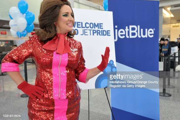 USA Comedian and 'air hostess' Pam Ann welcomes passengers at the ticket counter before boarding JetBlue's JetPride flight 1969 from San Francisco to...