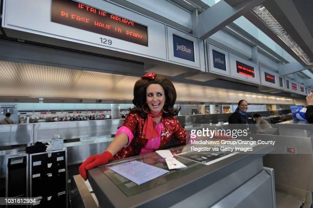 USA Comedian and 'air hostess' Pam Ann welcomes passengers to the ticket counter before boarding JetBlue's JetPride flight 1969 from San Francisco to...