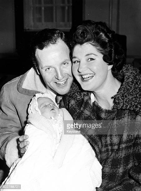 Comedian and broadcaster Nicholas Parsons with his wife Denise Bryer and their baby son Hugh Justin outside the London clinic where the baby was born...