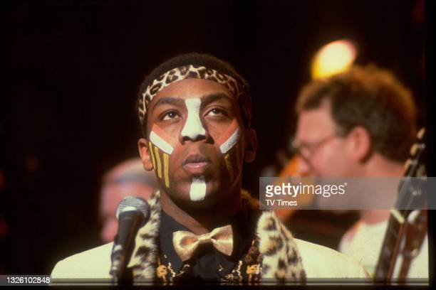 Comedian and comic actor Lenny Henry wearing face paint and leopard print during a sketch performance, circa 1982.