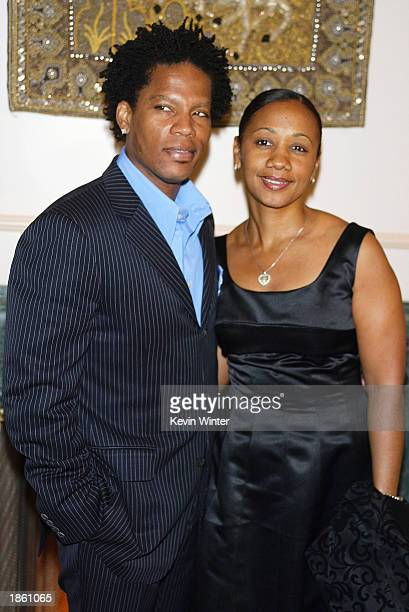 Comedian and event emcee DL Hughley and his wife LaDonna pose at Night of the Butterfly hosted by Chrysalis at a private residence on March 20 2003...