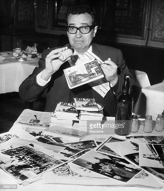 Comedian and goon, Michael Bentine fooling around at the launch of his book 'Fify Years on the Streets'.