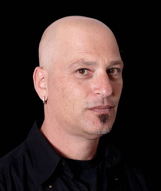 why did howie mandel shave his head
