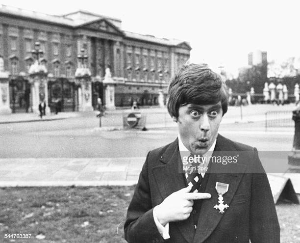 Comedian and impressionist Mike Yarwood joking around outside Buckingham Palace after receiving his investiture from HM Queen London December 8th 1976