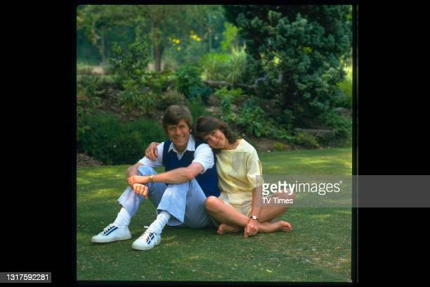Comedian and impressionist Mike Yarwood photographed at home with his wife, circa 1983.