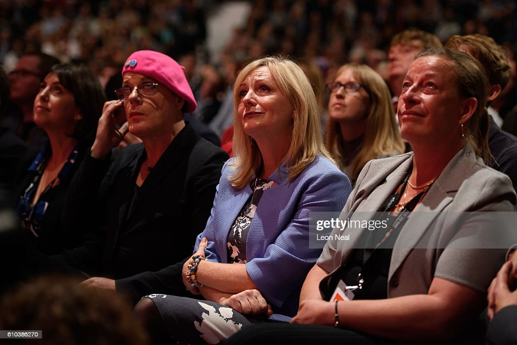 Comedian and Labour activist Eddie Izzard (L), Actress and Labour party by-election candidate Tracy Brabin (C) and Labour party activist Catherine Pinder (R) listen to a tribute to the murdered Labour MP Jo Cox on the first day of the Labour Party Conference in the Exhibition Centre Liverpool on September 25, 2016 in Liverpool, England. Party leader Jeremy Corbyn will hope to re-unite the party after being re-elected leader yesterday.