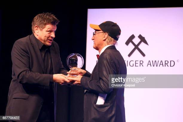 Comedian and laudatio seaker Bruno Guennar Knust hands out the entertainment award to Otto Waalkes during the Steiger Award on at Coal Mine Hansemann...