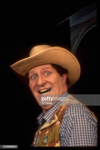 Comedian and magician Tommy Cooper dressed a cowboy, circa 1980.