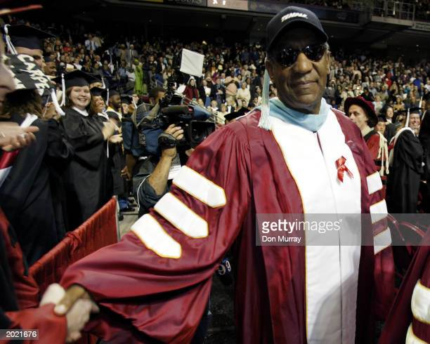 Comedian and member of the Board of Trustees of Temple University Bill Cosby enters the arena prior to speaking to the graduates of the Class of 2003...