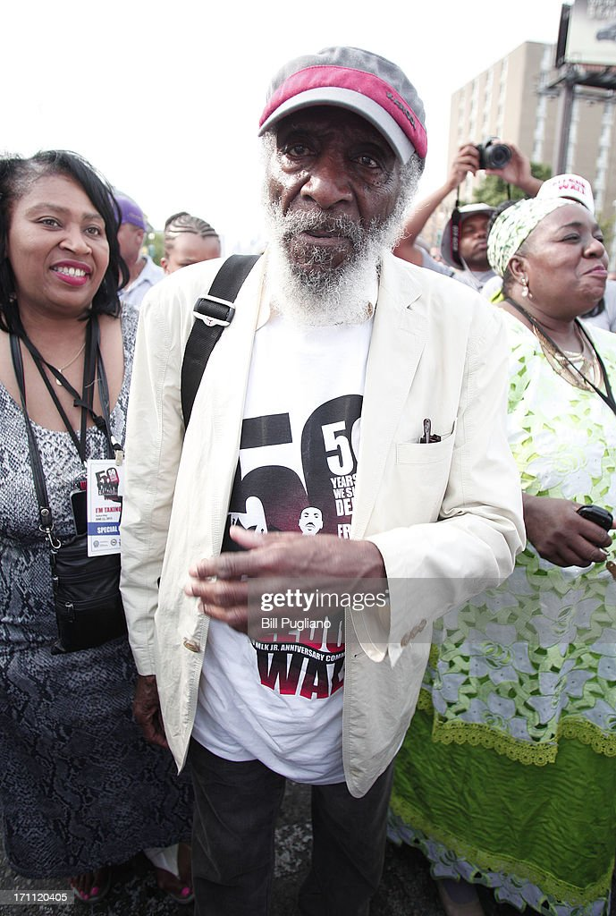 Comedian and social activist Dick Gregory marches in the 50th Anniversary Commemorative Freedom Walk June 22, 2013 in Detroit, Michigan. The march commerates the 50th anniversary of Dr. Martin Luther King's Walk To Freedom.