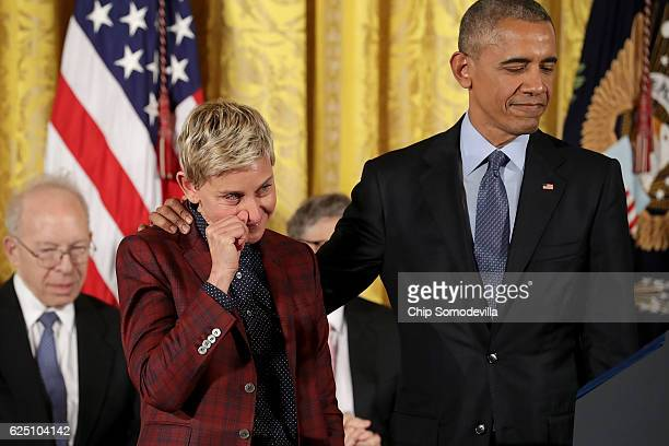 Comedian and talk show host Ellen DeGeneres wipes away tears as her citation is read before being awarded the Presidential Medal of Freedom by US...