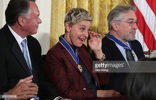 Comedian and talk show host Ellen DeGeneres wipes tears during a Presidential Medal of Freedom presentation ceremony at the White House November 22...