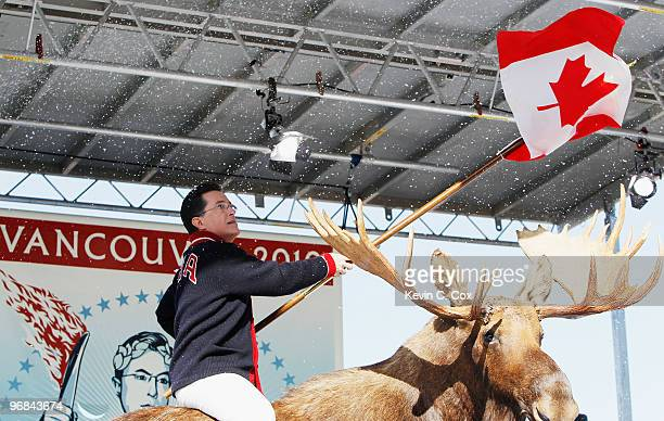Comedian and talk show host Stephen Colbert acknowledges the crowd while sitting on a stuffed moose and holding a Canadian flag on stage while taping...