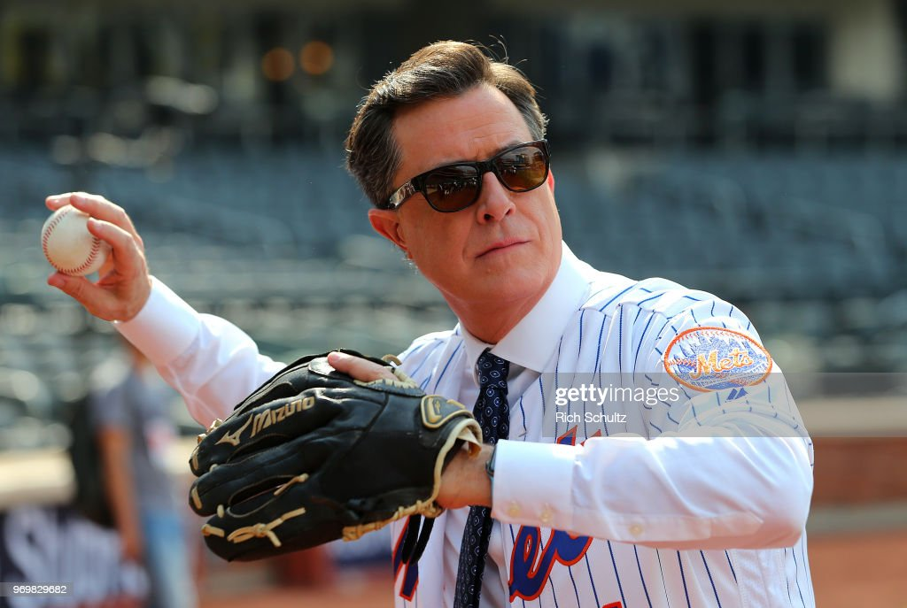 Comedian and talk show host Stephen Colbert plays catch before a game between the New York Yankees and New York Mets at Citi Field on June 8, 2018 in the Flushing neighborhood of the Queens borough of New York City.